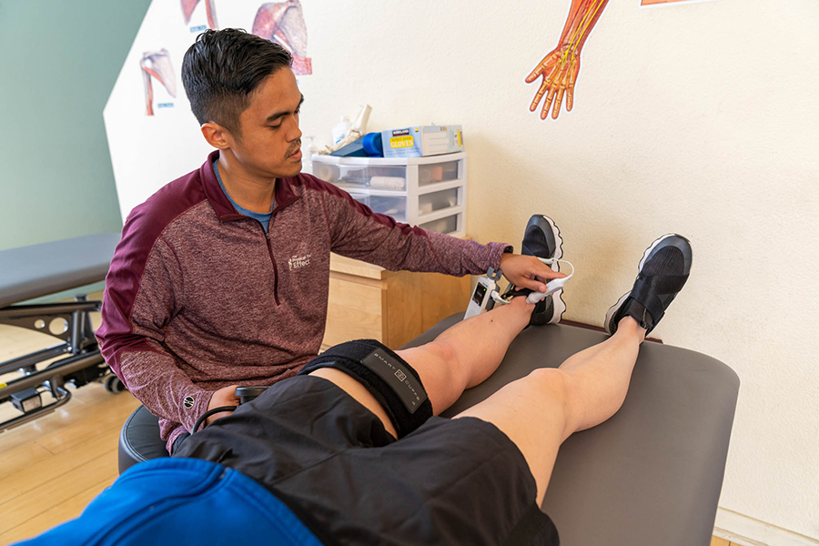 Doctor working on patient's legs
